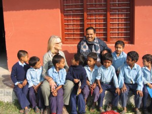 Nicki with Mr. Damodar, Headmaster and children in Nepal