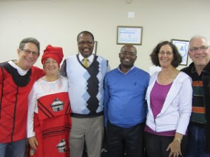 volunteers with Principal Thambo and Ace Lamani celebrating together