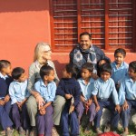 Volunteer Nicki with Principal Mr Damodar and some of the pupils