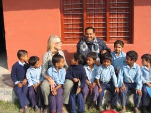Nicki with Mr. Damodar, Headmaster and children in Nepal