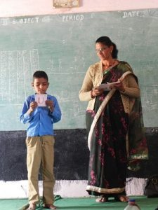 Class 2 teacher using flashcards